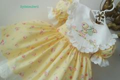 Embroidered child dress with LIttle duck design