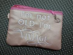 Embroidered handbag with I'm not old design