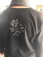 Embroidered sweater with rose design