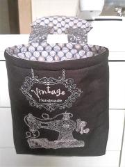 Embroidered textile basket with Sewing machine design