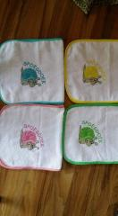 Se of embroidered bibs with snail design