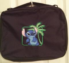 Travel bag with stitch free embroidery design