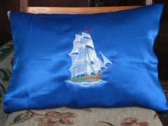 Blue pillow with Sea ship free embroidery design