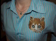 Woman shirt with kitty free embroidery design