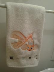 Bath towel with gold fish free embroidery design