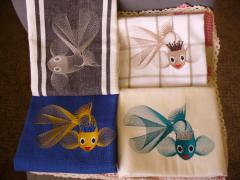 Embroidered towels with gold fish free design