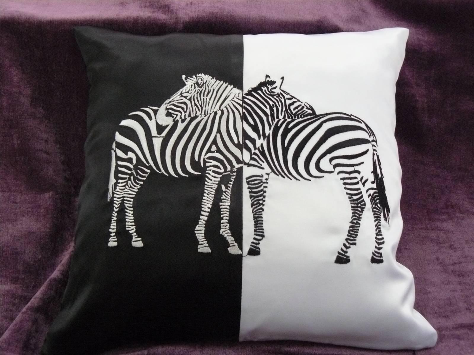 Embroidered pillow with two zebras design
