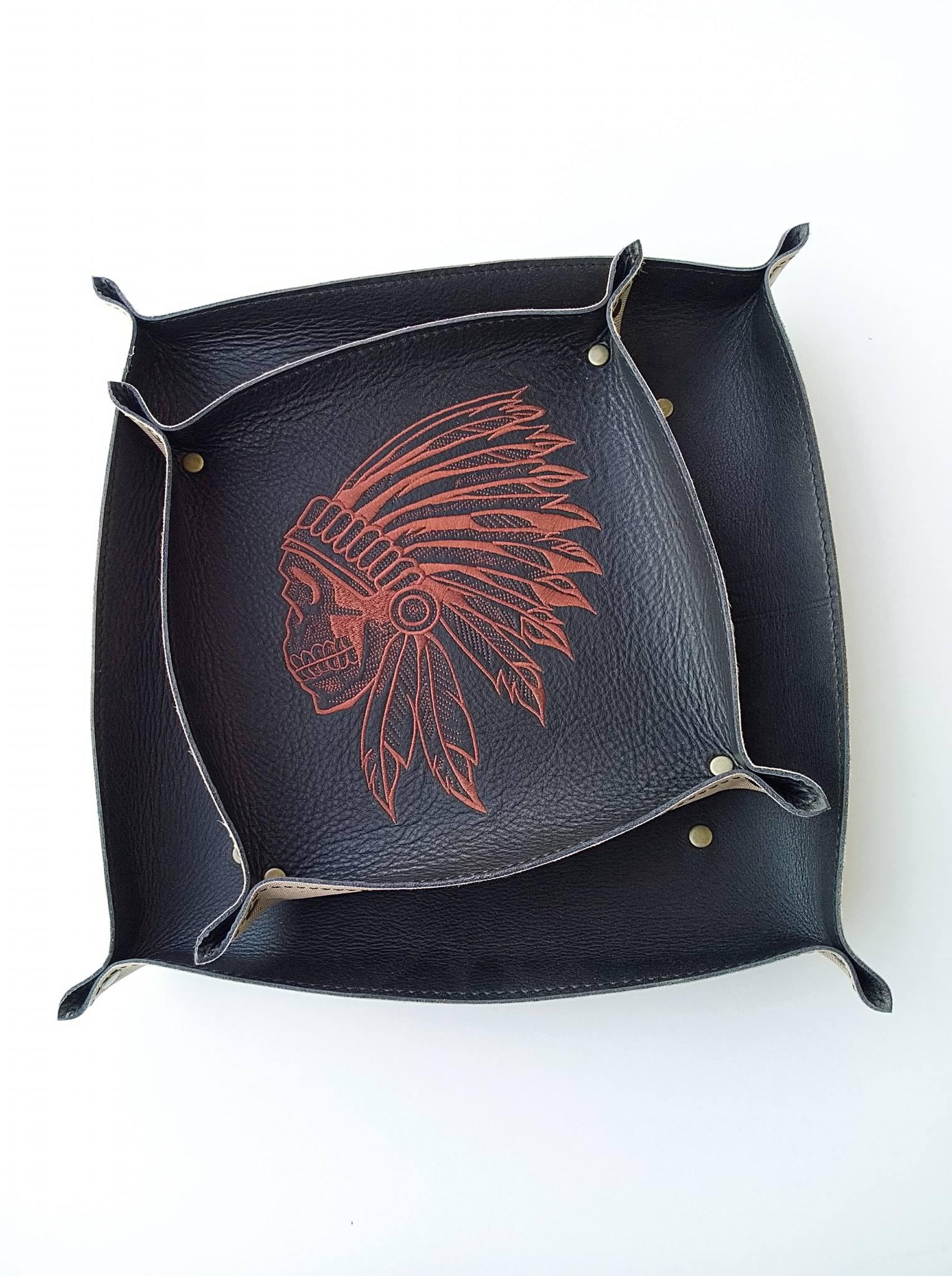 Embroidered leather plates with Indian skull design