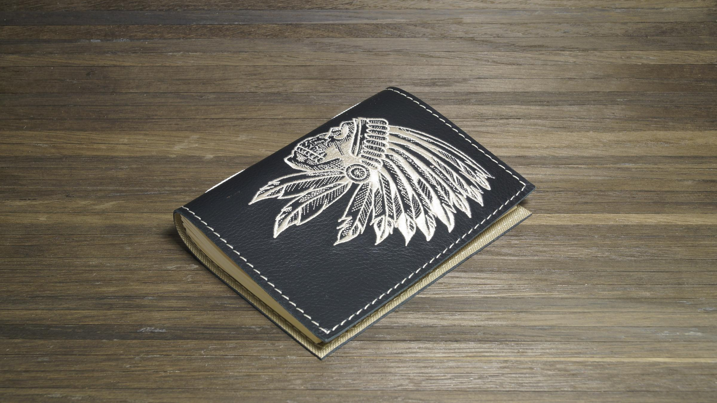 Embroidered notepad cover with Indian skull design