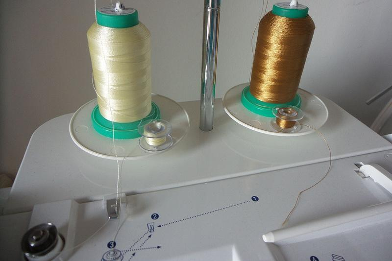 Upper and lower embroidery threads