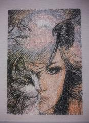 Embroidered picture with Woman and cat design