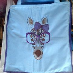 Embroidered bag with zebra design