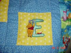 Quilt block with winnie Pooh painter letter E free machine embroidery design