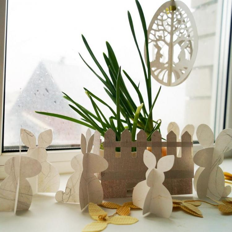 Easter decoration with bunnies and fence
