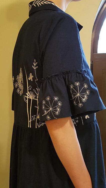 Embroidered dress with flower season design