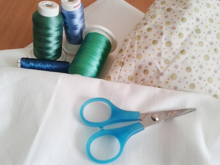 Embroidery threads, scissors and fabric