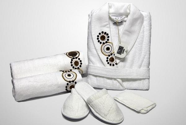White terry cloth bathrooms slippers, bathrobe and towels