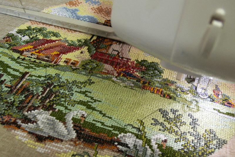 Cross stitch houses and pond