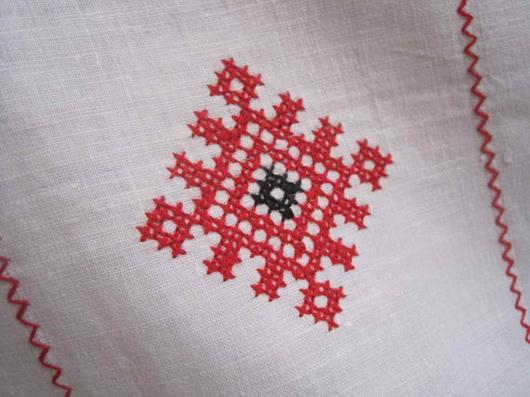 Cross stitch embroidery on linen