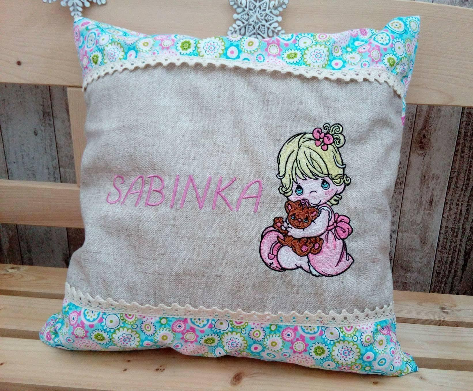 Adorable cushion with Precious Moments Girl and Toy embroidery design