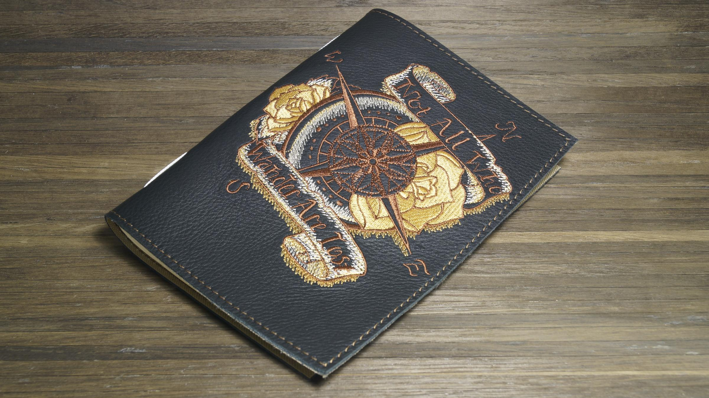 Embroidered leather cover with Wind rose design