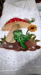 Embroidered towel with Frog under mushroom design