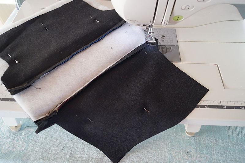 Two pieces of black fabric with padding