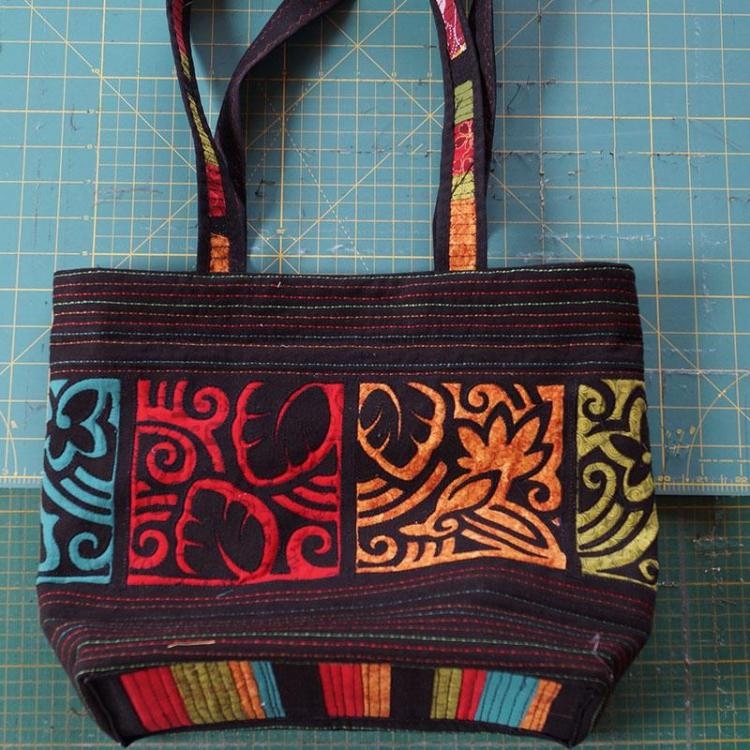Black bag with red, yellow, green and blue embroidery
