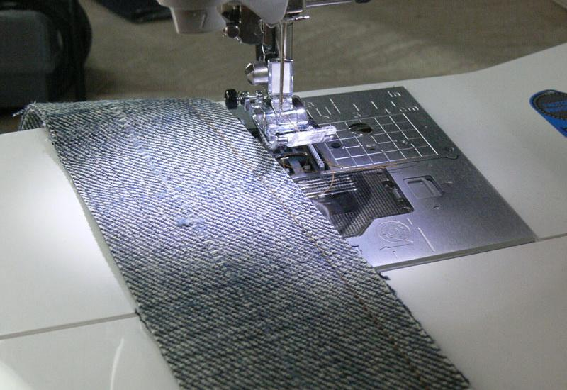 Denim strap being stitched