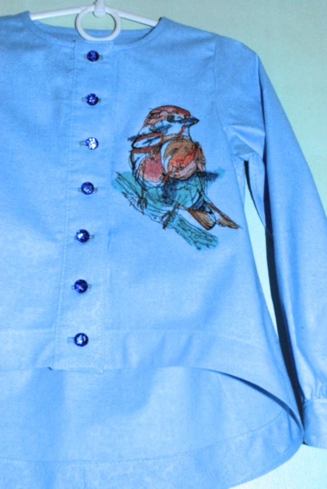 Embroidered woman's blouse with Bird design