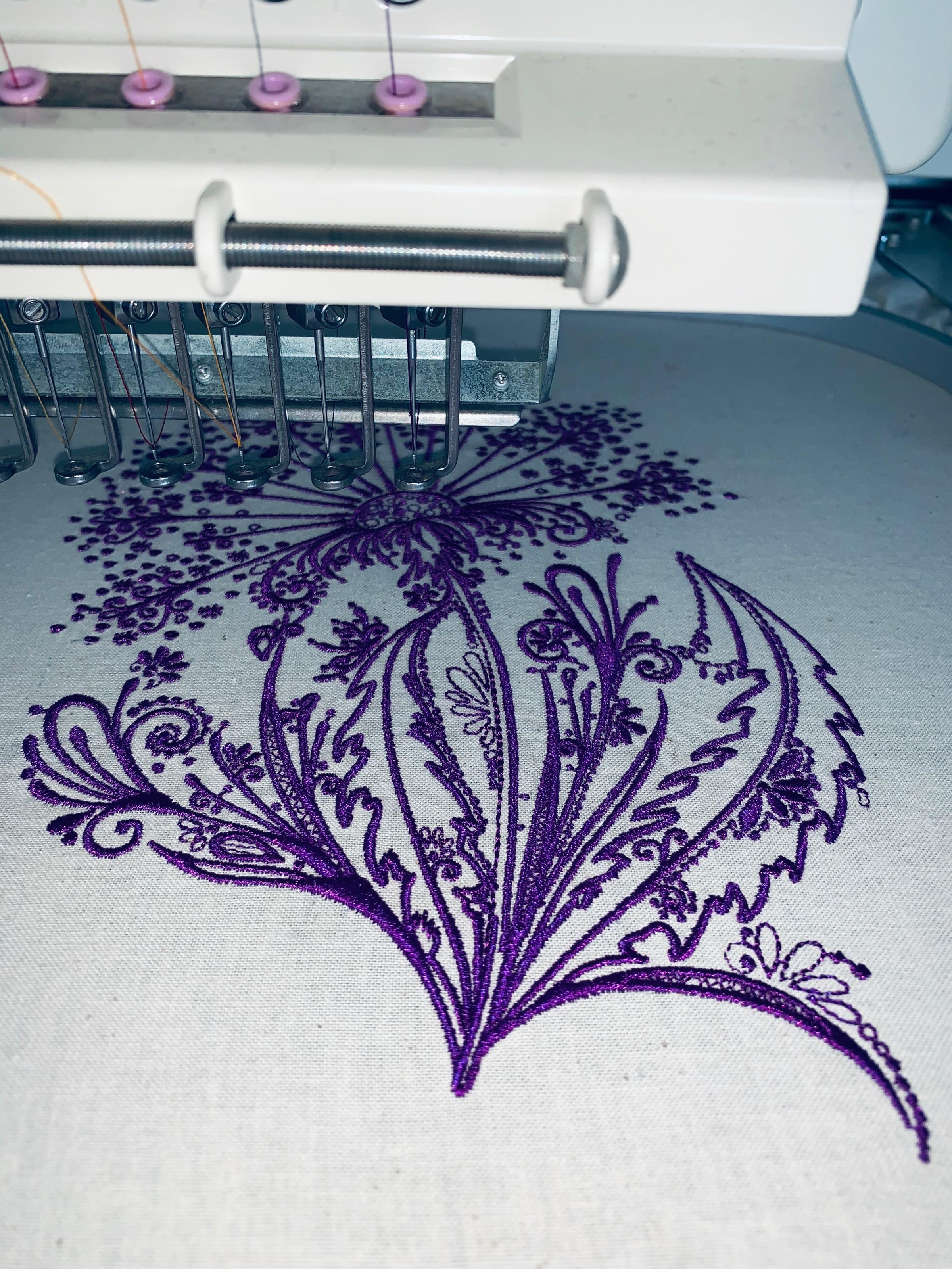 Dandelion embroidery design in sewing machine.