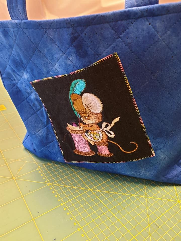 Embroidered bag with Writing mouse design