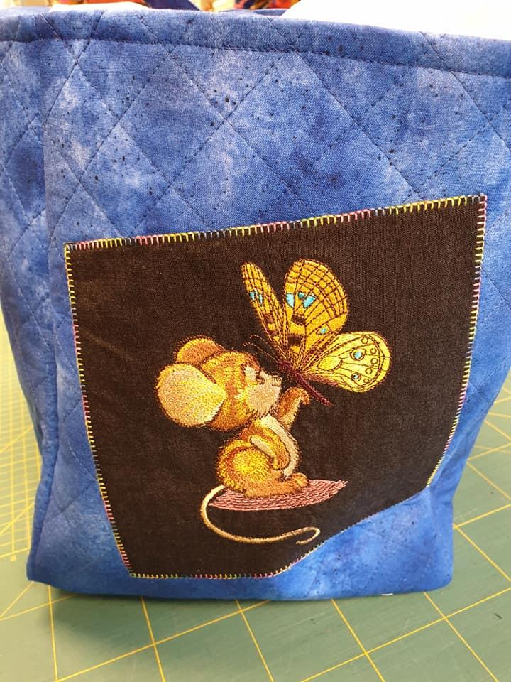 Embroidered basket with Mouse and butterfly design