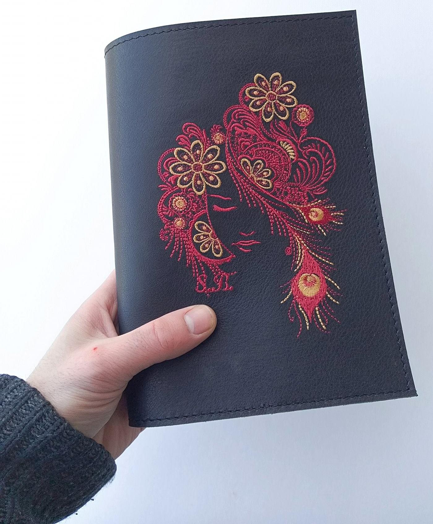 Embroidered cover for notepad with Firebird design