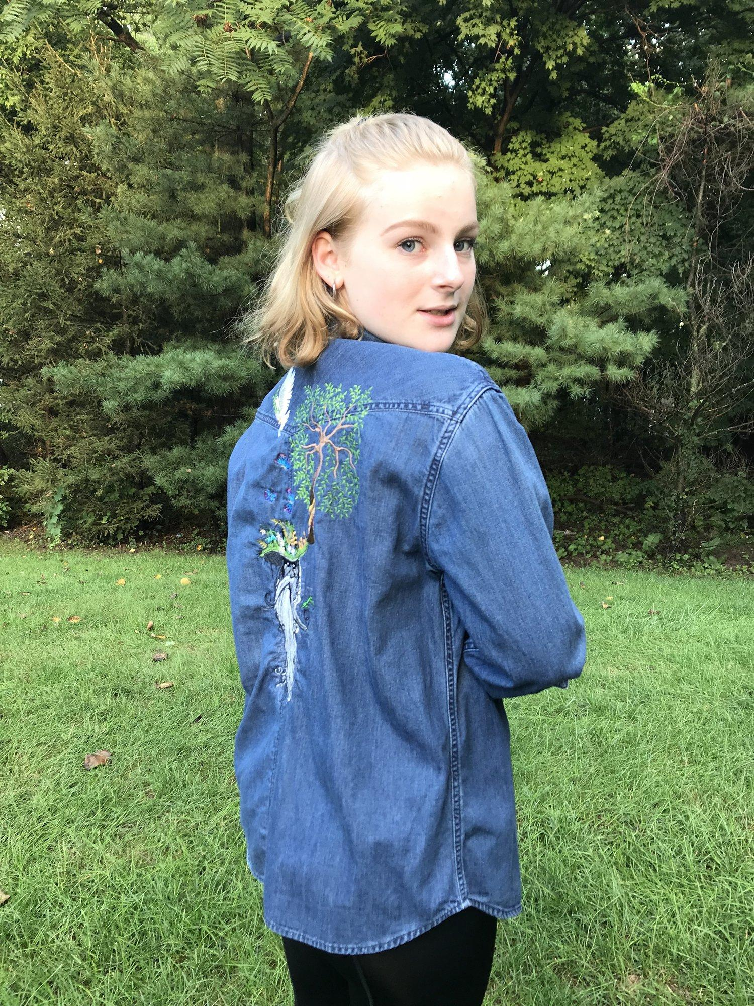 Embroidered jeans jacket with Root man design