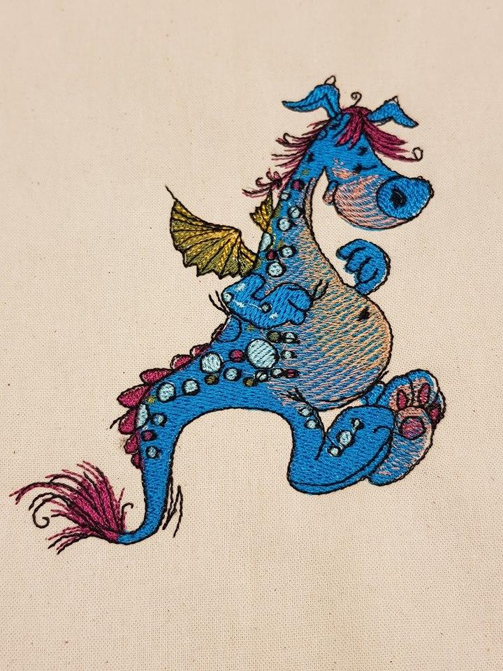 Funny dragon embroidery design