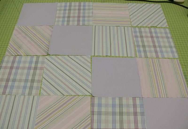 Sixteen square fabric pieces