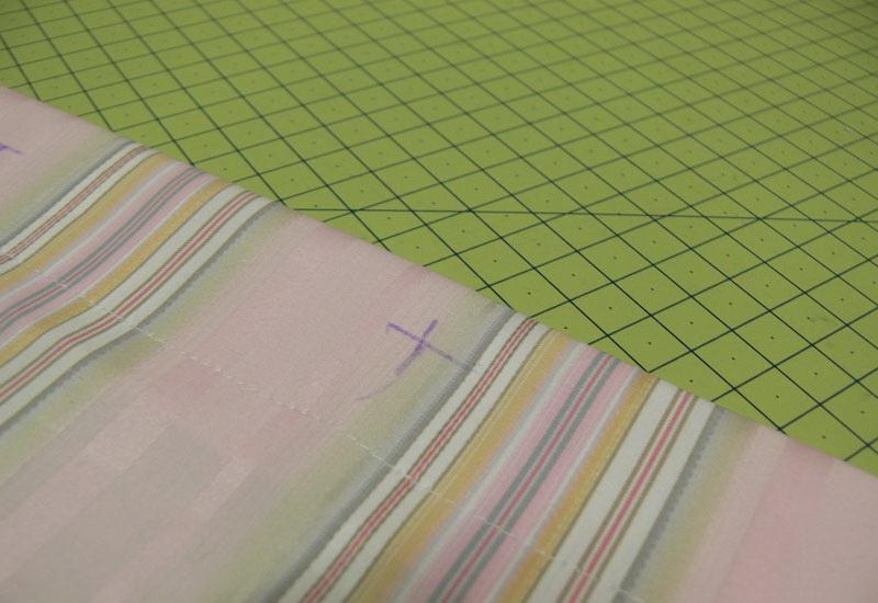 Fabric marked with a cross