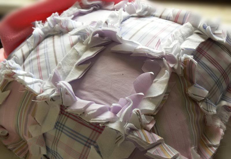 Patchwork pillow with frayed seam allowance