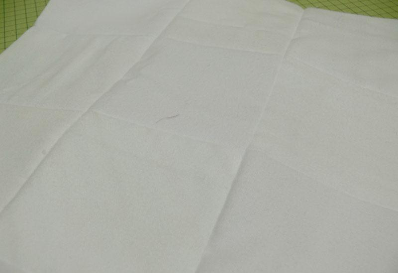 Square piece of white fabric