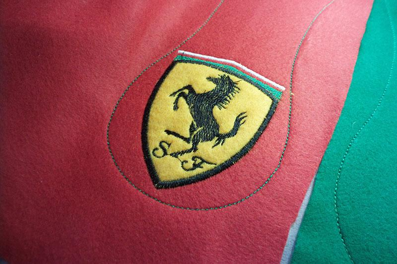 Horse logo on red fabric