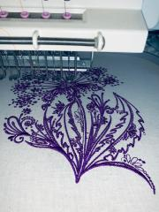 Dandelion embroidery design in sewing machine.