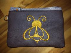 Embroidered cosmetics bag with Bee design