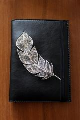 Embroidered cover with Feather design