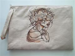 Embroidered handbag with Lady in flower crown design