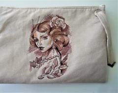 Embroidered handbag with Sad lady design