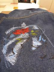 Embroidered jeans jacket with Rose under dome design