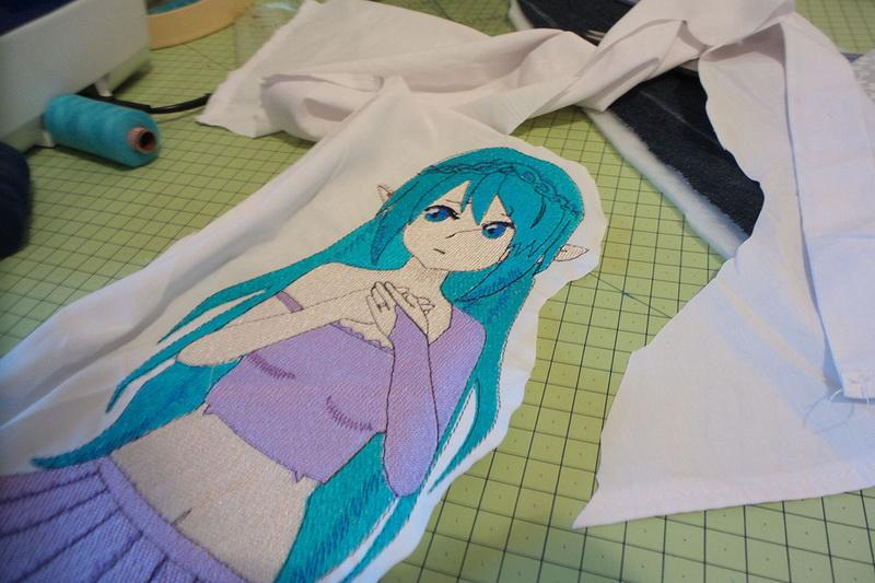 Girl with cyan hair being cut out