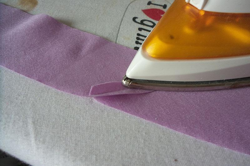 Seam being pressed open and flat with an iron