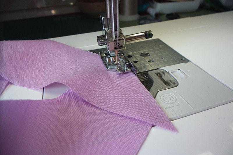Strips of fabric being stitched together